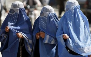 A traditional burqa - enveloping outer garment worn by women in some Islamic traditions to cover their bodies when in public.