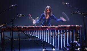 Evelyn Glennie, a deaf female percussionist,  plays marimba.