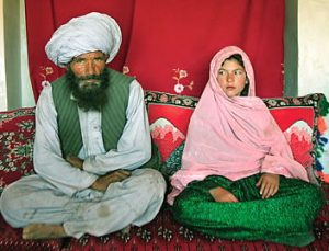 Soon to be wed Faiz Mohammed, 40, and Ghulam Haider 11, Ghowr Province, Afghanistan. (Photo by Stephanie Sinclair)