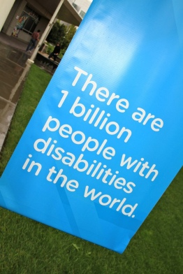 A sign stating a statistic about the amount of people with disabilities.