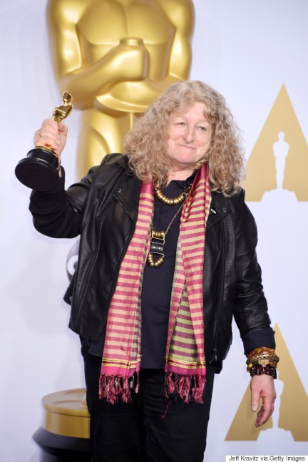 Jenny Beavan holds up her golden Oscar award
