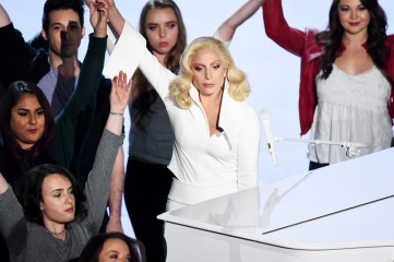 "Lady Gaga stands hand-in-hand with sexual assault survivors during her performance of ""Til It Happens To You"""