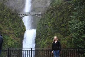 Madelyn Starritt pictured standing by Multnomah Falls in Oregon