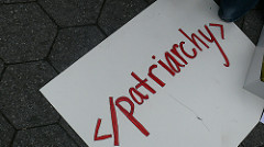 red code for a computer that says end patriarchy.