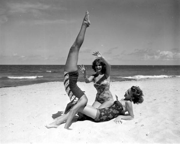 Three young women playing around on the beach - West Palm Beach, Florida, 1953.