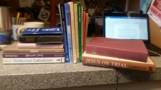 Books laying and standing in a group, all of a religious nature
