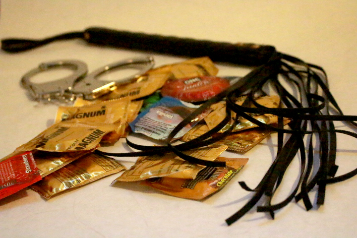 photo of condoms, handcuffs, and a whip.