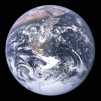 A photo of the Earth from space, a large blue marble on a black background