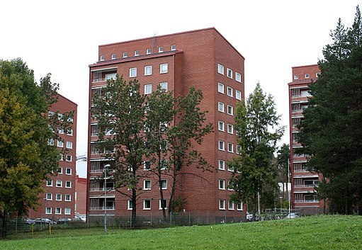 A brick building meant for students to live at on a college campus.