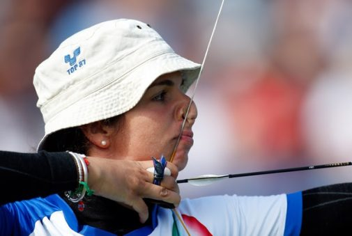 Nemati pulls back her bow across her face as she prepares to shoot in the London Paralympics.