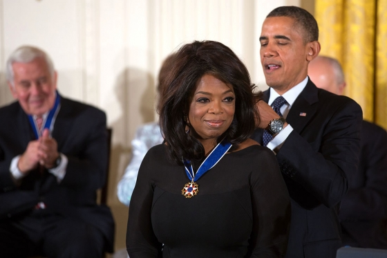 President Obama awarding Oprah Winfrey with a medal