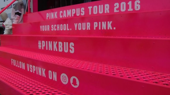 PINK Bus stairs reading, Pink Campus Tour 2016. Your School. Your Pink. #pinkbus. Follow vspink on snapchat and instagram