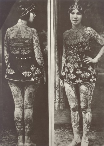 A Victorian woman with tattoos from neck to toe
