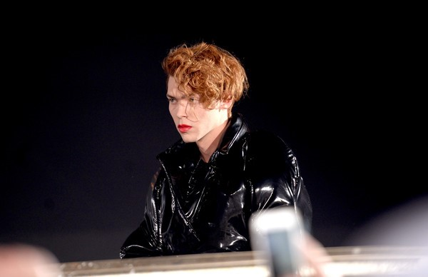red headed dj SOPHIE performs at Coachella 2016 in a black leather jacket