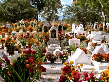 Cemeteries are decorated with flowers and candles.
