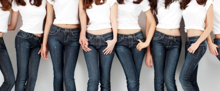 midriff shot of women standing aside onanother