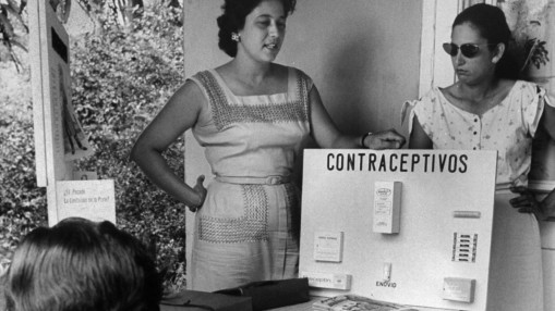Black and white photograph of two women teaching about birth control options in 1960