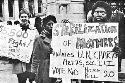 Black and white photograph of women holding protest signs