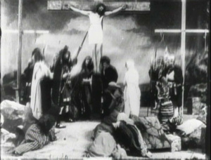 Scene from The Life of Christ. Jesus is being hoisted onto the cross