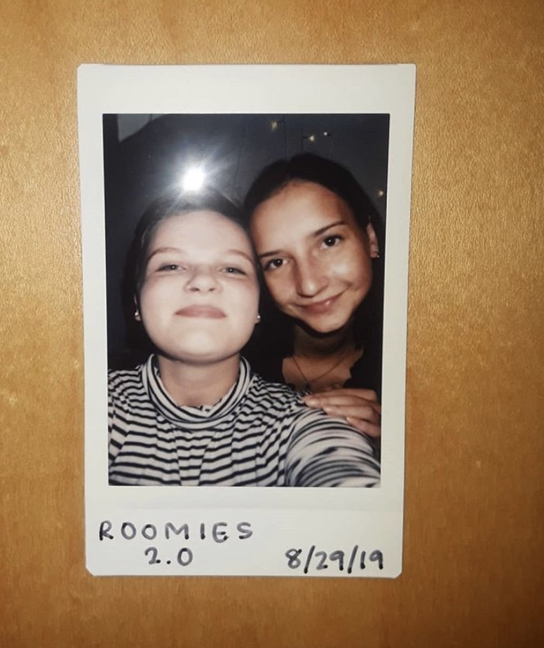 "A poloroid photo of two young females with short hair captioned ""Roomies 2.0 8/29/19"""