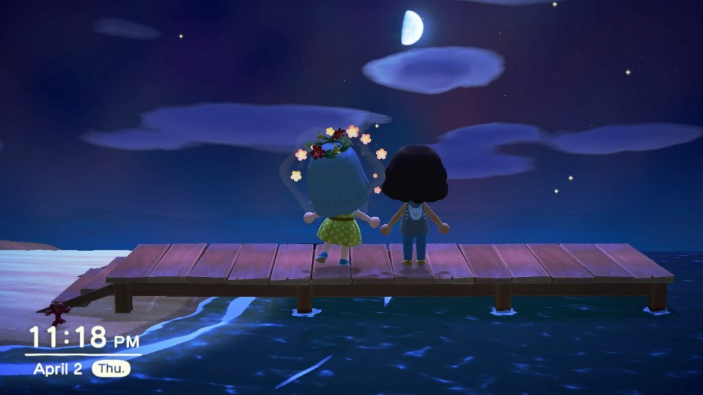 Two animated characters standing on a dock under a half moon.